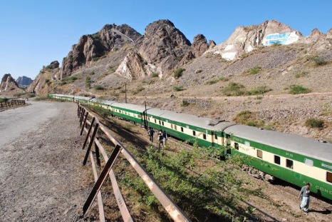 train-passing-through-the-mountainous-ridge-near-railway-bridge-at-chenab-near-chiniot